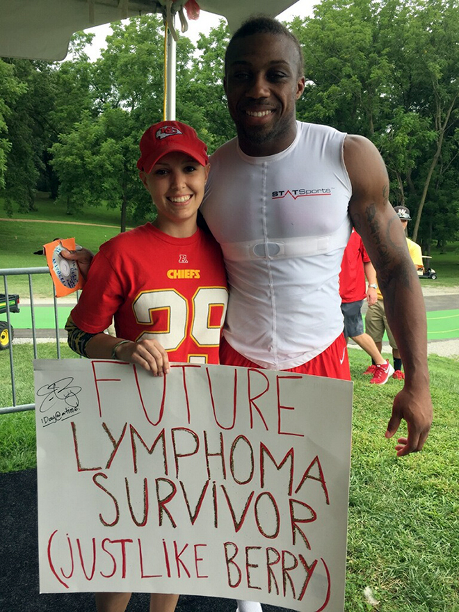 Contributed photo Alyssa Crabtree, 24, poses with Kansas City Chiefs safety Eric Berry with her home-made sign following the team's training camp practice on Wednesday, Aug. 5 in St. Joseph, Mo. A 2009 Platte County High School graduate, Crabtree was recently diagnosed with lymphoma. A three-time Pro Bowl selection, Berry, 26, was diagnosed with lymphoma late last season and recently returned to practice just eight months later.