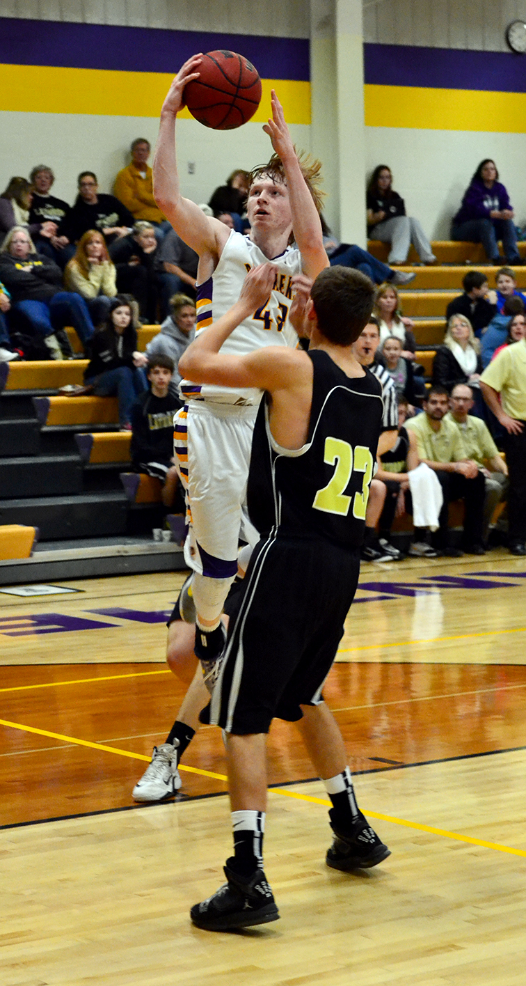 BRYCE  MERENESS/Citizen photo North Platte's Andrew Roberts, rear, goes in for a layup against Lathrop during a Friday, Feb. 6 game vs. Lathrop at North Platte High School in Dearborn, Mo.