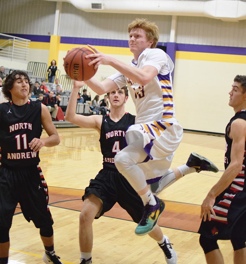 BRYCE MERENESS/Citizen photo North Platte senior guard Andrew Roberts, center, goes for a layup against a trio of North Andrew defenders during a game Monday, Jan. 4 at North Platte High School in Dearborn, Mo.