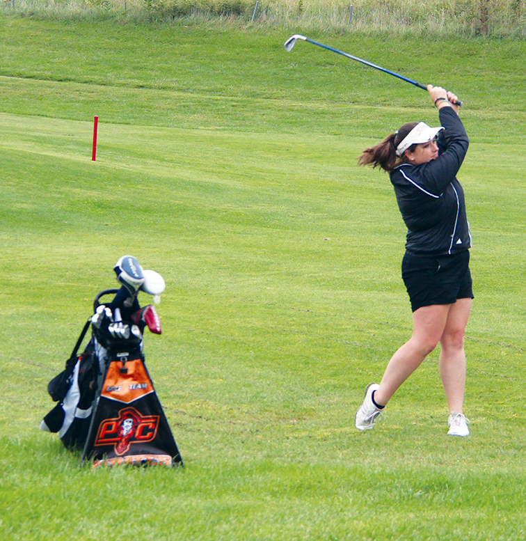 ROSS MARTIN/Citizen photo Platte County's Ashleigh Beamer watches an approach shot on No. 9 at Shiloh Springs Golf Club during last week's Platte County Invitational.