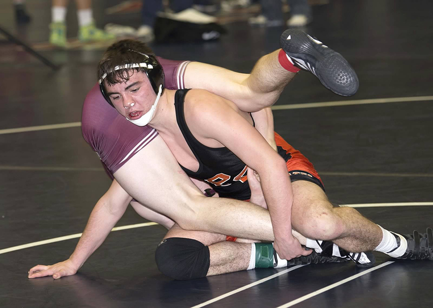 DAVID BREDESON/Special to The Citizen Platte County's Caleb Crabtree, right, wrestles with an opponent at the Allen Outlaw in Allen, Texas. Platte County finished second in the two-day tournament with 474 points, 113 behind the winners and hosts.