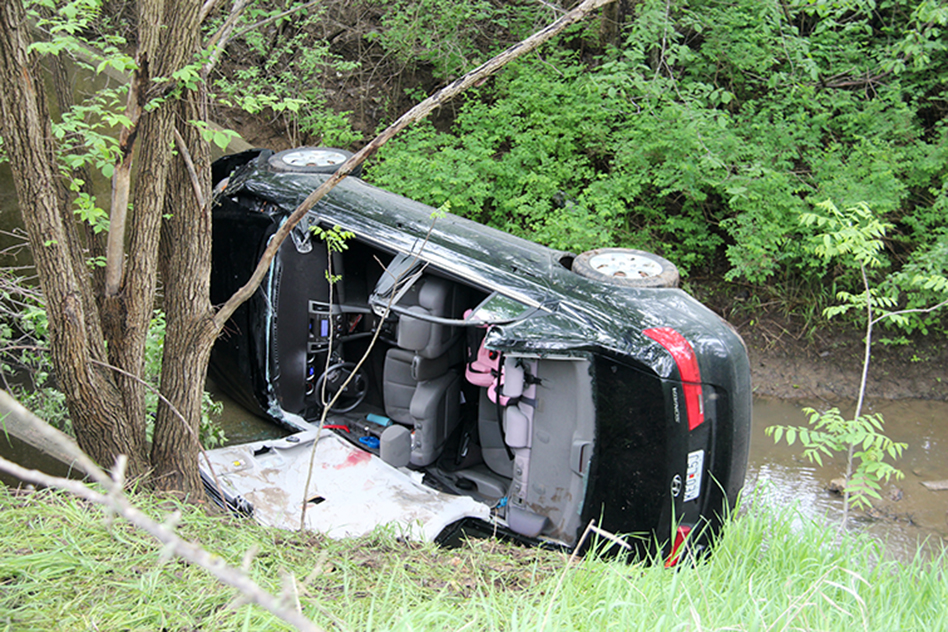 ROSS MARTIN/Citizen photo A Hyundai Sonata driven by William Sluder, 44, of Platte City, Mo. can be seen laying on its side in a drainage ditch off of Interstate 29, near mile marker 17 just south of the Highway 92, following a one-vehicle accident Thursday, May 14. Sluder apparently drove off the right side of the road and behind the guardrail before going airborne into the stream.