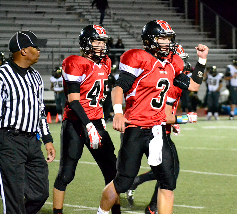 Citizen file photo Park Hill seniors Carter Anchors, right, and Clayton Cole celebrate following a defensive stop during the Trojans' 44-33 win against Lee's Summit on October 3, 2014 at Park Hill District Stadium in Kansas City, Mo.