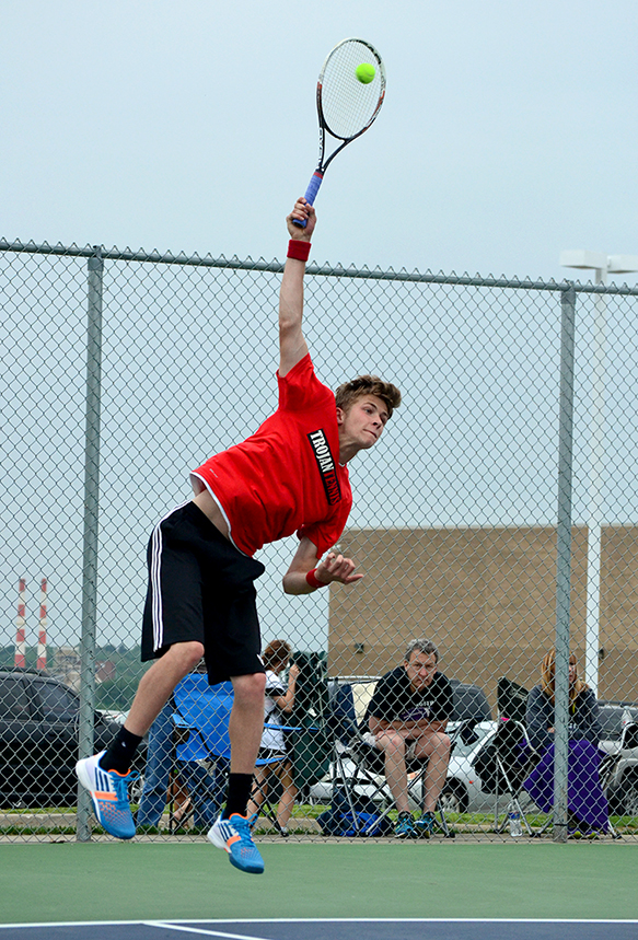 BRYCE MERENESS/Citizen photo Park Hill sophomore Jake McFee hits a serve during a No. 2 doubles match against Park Hill South in the Class 2 District 15 championship dual on Wednesday, May 13 at Park Hill South High School in Riverside, Mo.
