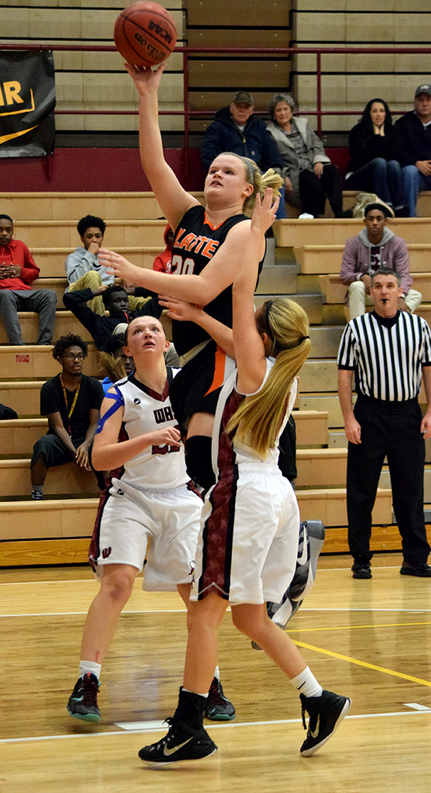 BRYCE MERENESS/Citizen photo Platte County junior forward Liz Peterson, center, attempts a shot between Winnetonka defenders in the opening round of the Winnetonka Invitational on Monday, Nov. 30 at Winnetonka High School in Kansas City, Mo.