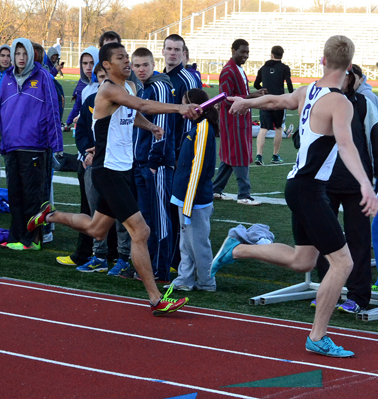 BRYCE MERENESS/Citizen photo Park Hill South senior Darrien Case, left, hands the baton to Isaac Frieden during the 4x800-meter relay on Friday, April 3 at the North Kansas City District Activities Center in Kansas City, Mo.