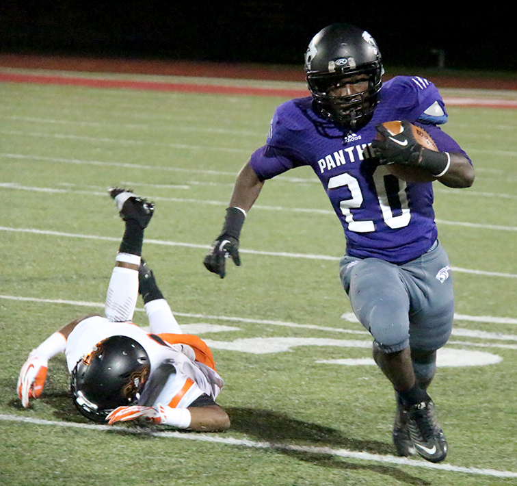 ROSS MARTIN/ Citizen photo Park Hill South running back Derek Cook (20) runs past Platte County defensive back Lloyd Lockett Sept. 12 at Park Hill District Stadium in Kansas CIty, Mo.