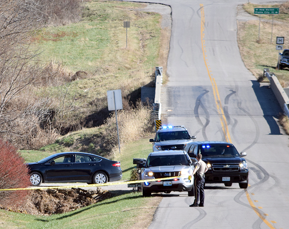 BRYCE MERENESS/Citizen photo Emergency crews cordon off the scene outside a home in rural Platte County on Monday, Nov. 23 at the site of a potential drowning involving a 3-year-old boy who fell into a pond. The boy later died at an area hospital with drowning the reported cause of death.