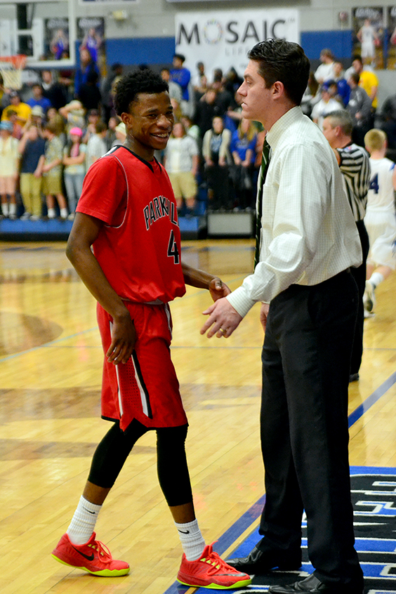 BRYCE MERENESS/Citizen photo Park Hill sophomore guard Dru Smith shares a laugh with the bench and coach David Garrison during a game against St. Joseph Central on Friday, Feb. 20 in St. Joseph, Mo.