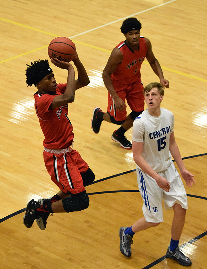 BRYCE MERENESS/Citizen photo Park Hill junior guard Dru Smith, left, goes up for a shot against St. Joseph Central during the third-place game of the Liberty North Invitational on Friday, Dec. 11 at Liberty North High School in Liberty, Mo.