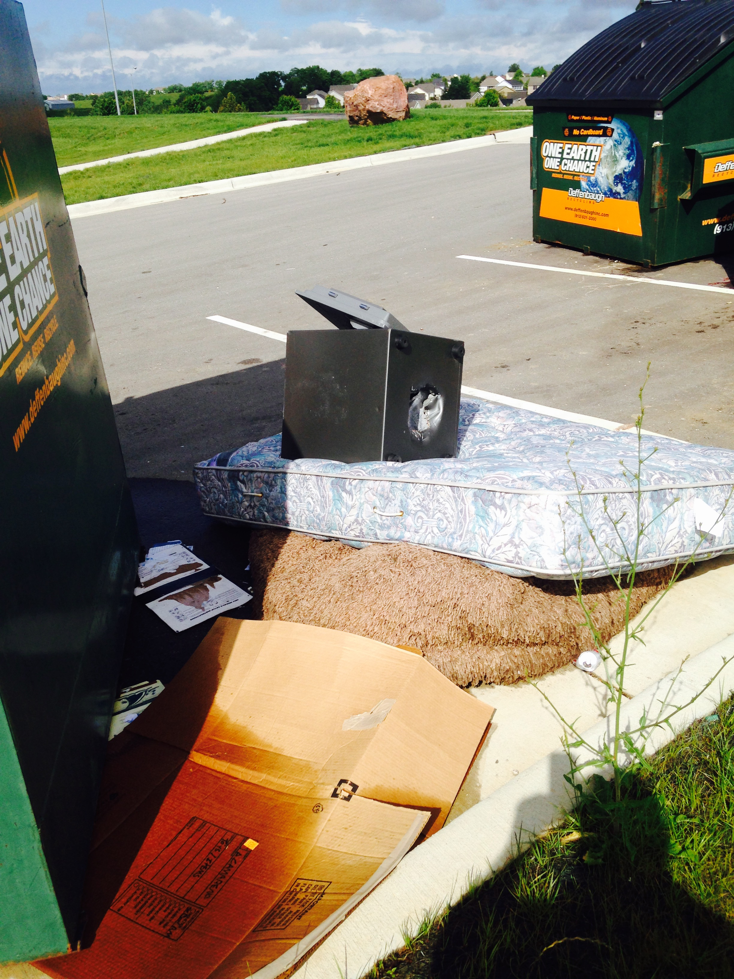 Contributed photo A large safe sits on top of a mattress placed on rolled up carpet outside of a recycling bin located at Platte County Community Center North in Platte City. Officials have grown increasingly concerned with the illegal dumping on site and might discontinue the recycling public service if it continues.