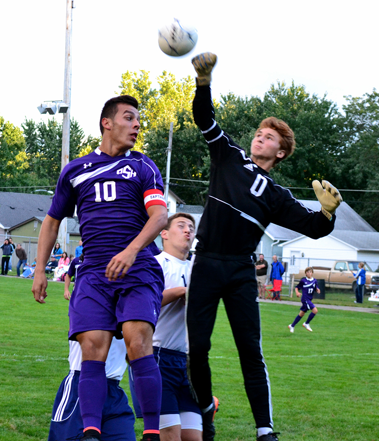 BRYCE MERENESS/Citizen photo Park Hill South forward Dylan Kintner (10) contests a ball Sept. 15 at The Den in St. Joseph, Mo., while Central goalkeeper Brendan Ryan (0) punches the ball clear. The Panthers won 3-0 to improve to 7-2.