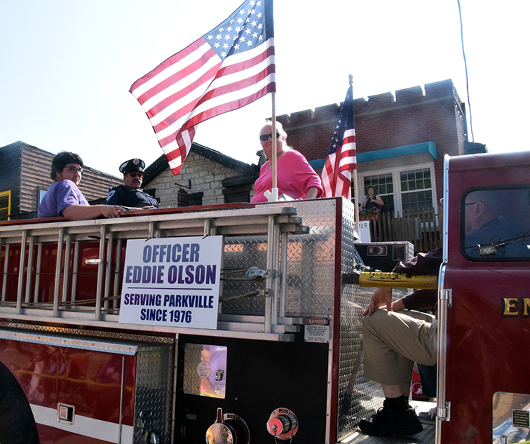 Citizen file photo The City of Parkville honored Edward Olson, center, during its Parkville Days parade this past August. Olson retired this week after 39 years on Parkville's police force.