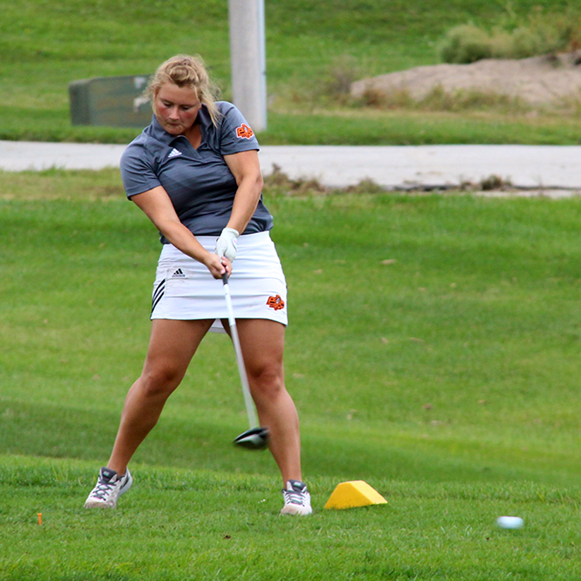 BRYCE MERENESS/Citizen photo Platte County's Emma Reynolds hits a drive Monday, Sept. 21 in the Suburban Conference Blue Division Tournament at Paradise Point Golf Complex in Smithville, Mo.