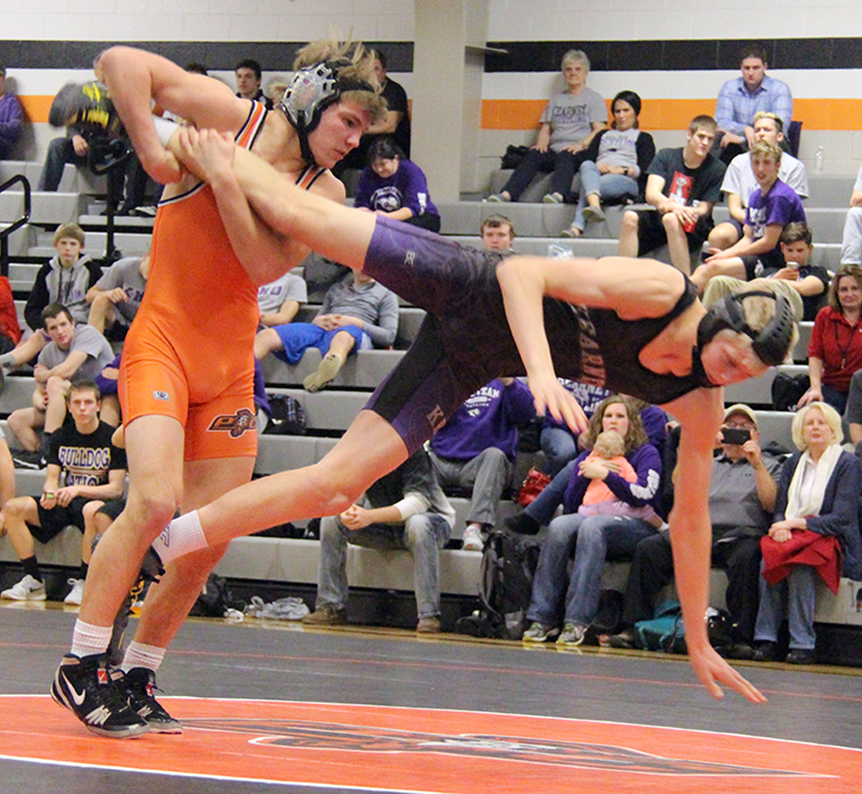ROSS MARTIN/Citizen photo Platte County senior Ethan Karsten, left, holds on to the leg of Kearney's Ethan Locke in their 145-pound match during a dual Tuesday, Feb. 2 at Platte County High School. Entering districts, Karsten has 184 career victories, ranking third behind teammate Matthew Schmitt (186) and Collin Wittmeyer (185).