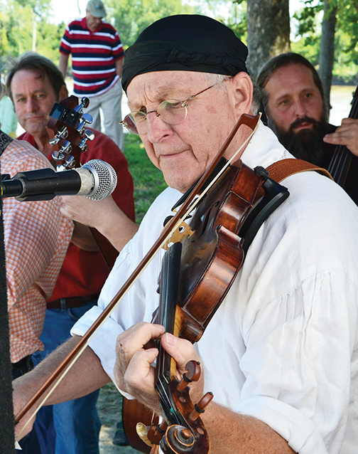 BRYCE MERENESS/Citizen photo Michael Fraser plays his fiddle during a ceremony Sept. 6 at Platte Landing Park in Parkville, Mo. honoring the sinking of the Steamboat Arabia near the area.