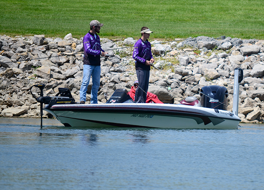 BRYCE MERENESS/Citizen photo Park Hill South sophomore Bryce Soske, left, and junior Caleb Lenhert, center, fish during the Panther Classic open bass fishing tournament on Sunday, May 3 at Smithville Lake in Smithville, Mo.