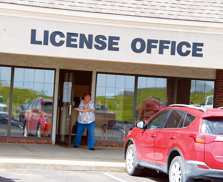 ROSS MARTIN/Citizen photo A customer exits the Platte City License Bureau's new location on the morning of Tuesday, April 14 at 1211 Branch St. in Platte City.