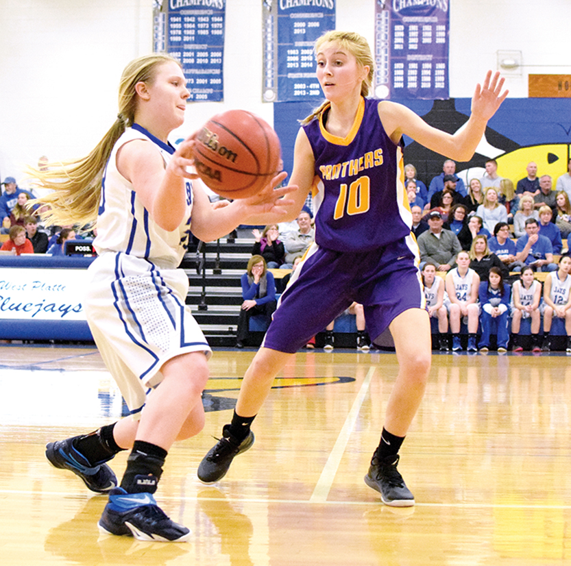 BRYCE MERENESS/Citizen photo North Platte sophomore guard McKenna Fulton, right, guards West Platte sophomore guard Karen Knox as she brings the ball up the court on Friday, Jan. 8 at West Platte High School in Weston, Mo.