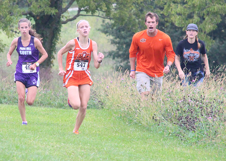 ROSS MARTIN/Citizen Photo Platte County freshman Rebekah Geddes, right, and Park Hill South sophomore Lexi Maddox, left, sprint to the finish of the Platte County Invitational last Thursday at Platte Ridge Park. Geddes won the individual race while Maddox and the Panthers claimed the team title.
