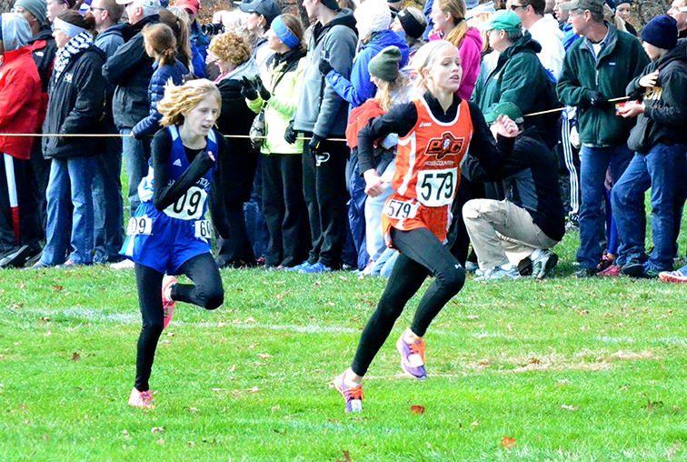 Platte County freshman Rebekah Geddes runs the course at Oak Hills Golf Center in Jefferson City, Mo. during Nov. 8's Class 4 Missouri State Cross Country Championships. Geddes finished 16th to earn all-state honors.
