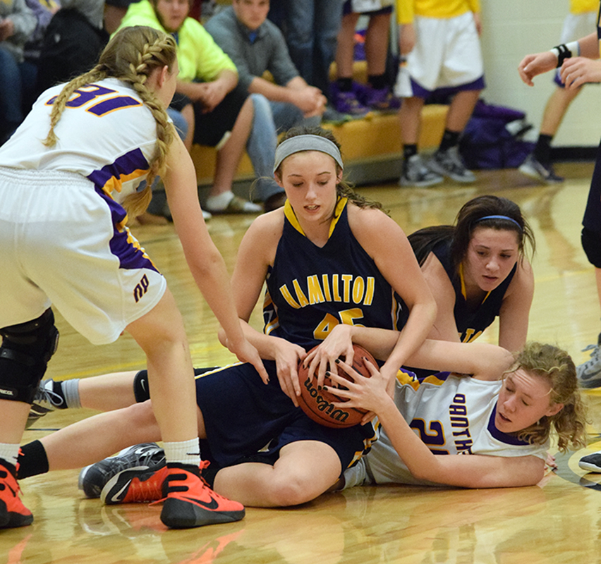 BRYCE MERENESS/Citizen photo North Platte senior forward Brittney Gerling, lower right, fights for a loose ball against Hamilton during KCI Conference play on Friday, Jan. 22 at North Platte High School in Dearborn, Mo.