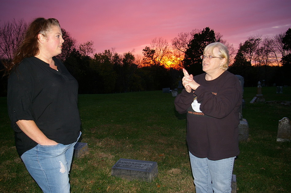 JEANETTE BROWNING FAUBION/Citizen photo Bev Slocombe, right, and Debbie Phan — both Edgerton residents — discuss their paranormal experiences during a recent visit to the Ridgely Cemetery, located near Edgerton, Mo.