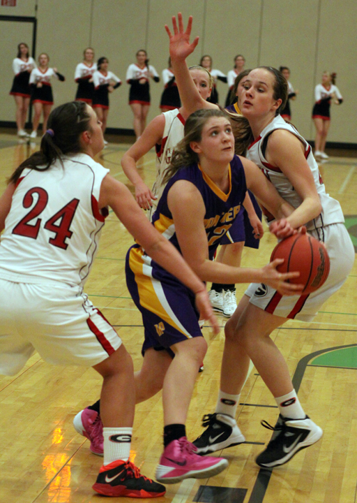 Chelsi Sams darts between two Gallatin defenders on a drive to the basket.