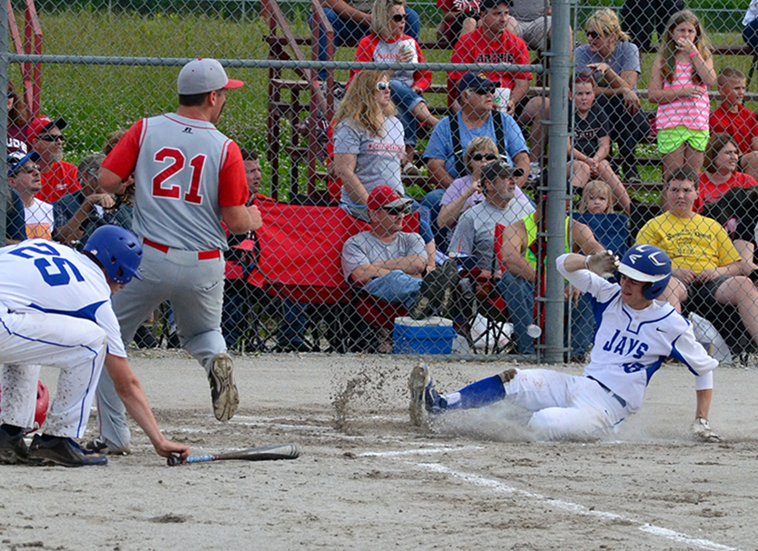 BRYCE MERENESS/Citizen photo West Platte's Grant Eagan, right, slides safely into home after an RBI single from Luke Horseman in the bottom of the first inning of a Class 2 sectional game against Archie on Monday, May 25 at Archie, Mo.