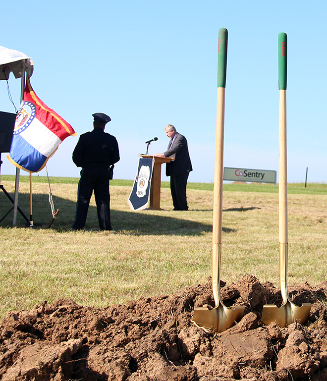 ROSS MARTIN/Citizen photo Kansas City city councilman Ed Ford, right, speaks from a lectern with Kansas City Police chief Darryl Forte looking on during a groundbreaking ceremony for the department's new North Patrol headquarters held Friday, July 17 in Kansas City, Mo. The new building will be located in Platte County on NW Prairie View Road, off of Interstate 29.