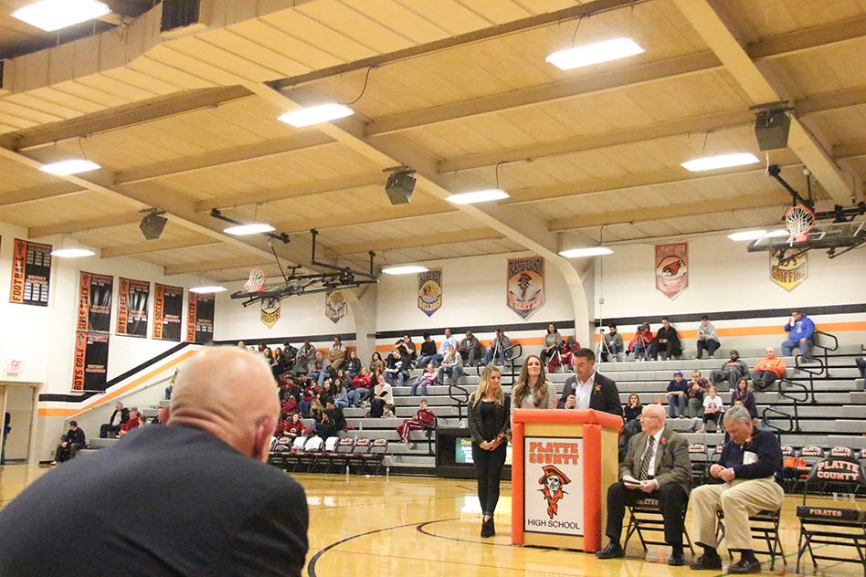 ROSS MARTIN/Citizen photo Bob Zubeck, left, looks on as his three kids, from left, Ellen, Ashley and Bobby accept Tina Zubeck's posthumous induction into the Pirate Hall of Fame during a ceremony at halftime of the Platte County boys basketball game on Friday, Feb. 27 at Platte County High School. At right are Wendell Doyle and R.B. Miller, the other two member's of this year's hall of fame class.