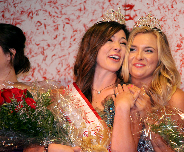 ROSS MARTIN/Citizen photo Sarah Regan, 20, of Platte City (left) receives the crown as the winner of this year's Platte County Fair Queen competition held Wednesday, July 22 at the Platte Pavillion on the Platte County Fairgrounds in Tracy, Mo. Karlye Horn (right), last year's queen, made the presentation.