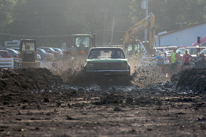 ROSS MARTIN/Citizen photo A truck kicks up mud during the Mud Marathon event held Friday, July 24 at the Grandstand on the Platte County Fairgrounds in Tracy, Mo. during the 152nd annual Platte County Fair.
