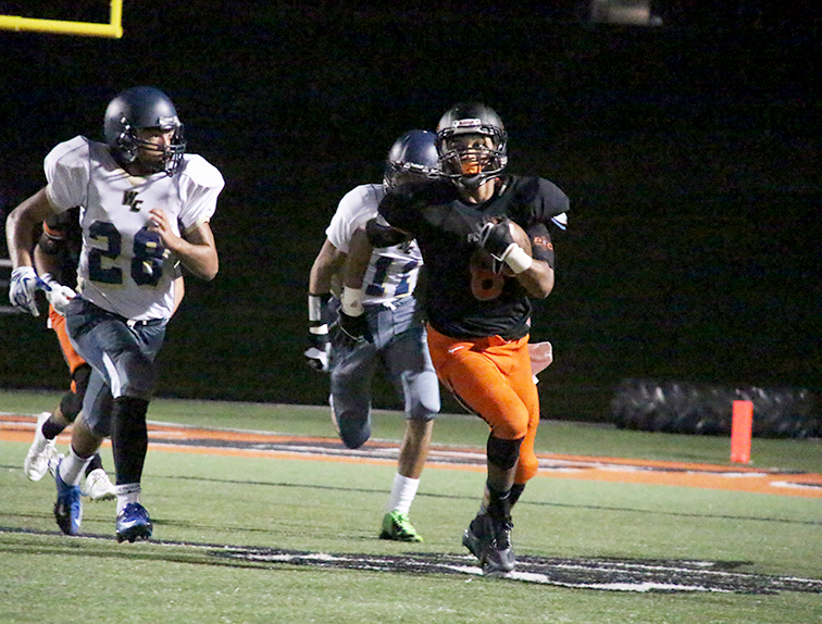 ROSS MARTIN/Citizen Photo Platte County wide receiver Aliek Reed, right, runs away from William Chrisman defenders Kyron Moss (28) and Chris Anderson (11) after hauling in a pass Friday Aug. 20 at Pirate Stadium. Platte County won 41-0 and looks to go 2-0 for the first time in seven seasons this week.