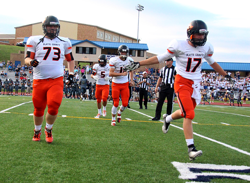 ROSS MARTIN/Citizen photo Platte County captains Dane Rader (73), Alex Minter (5), Tyler Clemens (18) and Zack Regan (17) head to the sideline after the coin toss before Friday, Aug. 21's game against William Chrisman at William Chrisman High School in Independence, Mo.