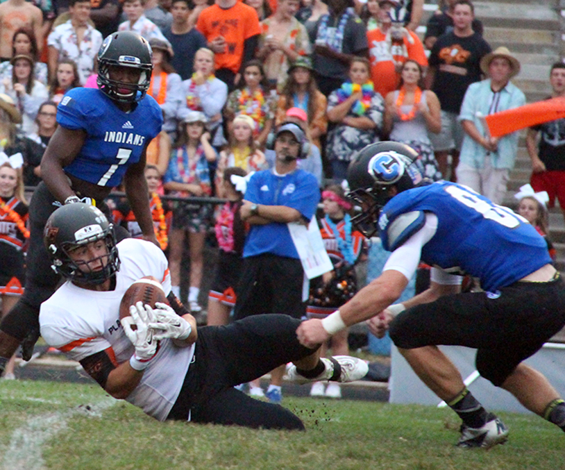 ROSS MARTIN/Citizen photo Platte County senior running back Alex Minter, center, slides to make a catch against St. Joseph Central on Friday Aug. 28 at Noyes Field in St. Joseph, Mo.