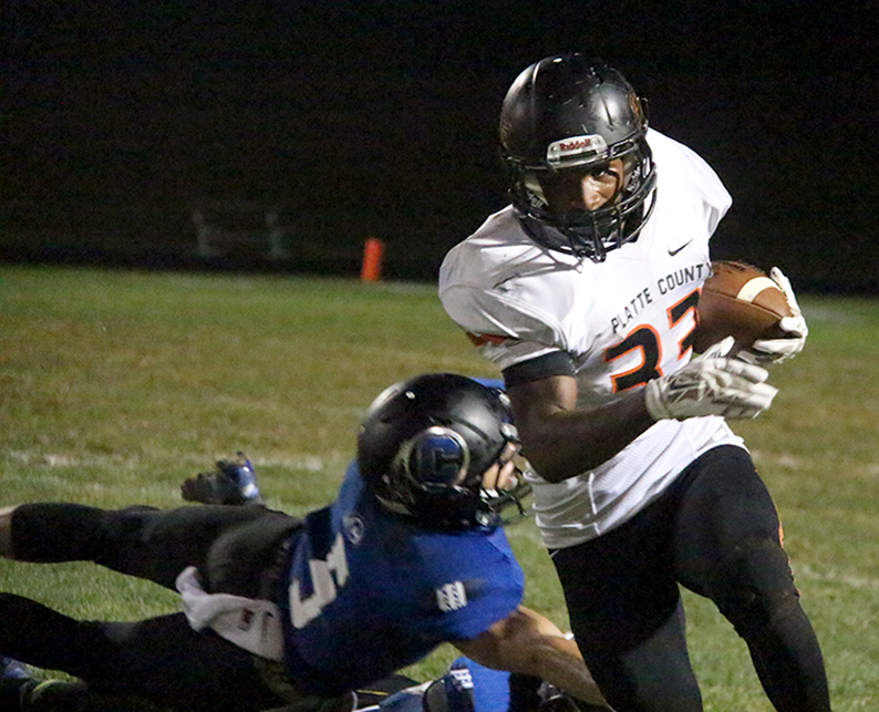 ROSS MARTIN/Citizen photo Platte County junior Mike McNair runs past St. Joseph Central senior Keith Roderick on Friday, Aug. 28 at Noyes field in St. Joseph, Mo.