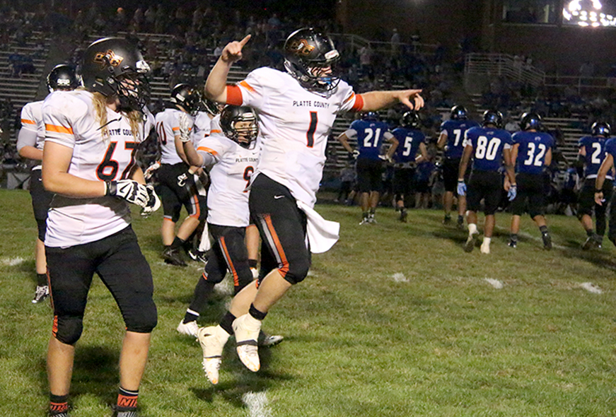 ROSS MARTIN/Citizen photo Platte County junior quarterback Justin Mitchell (1) celebrates along with offensive lineman Conner Welch, left, following Platte County's come-from-behind 41-34 win against St. Joseph Central on Friday, Aug. 28 at Noyes Field in St. Joseph, Mo.