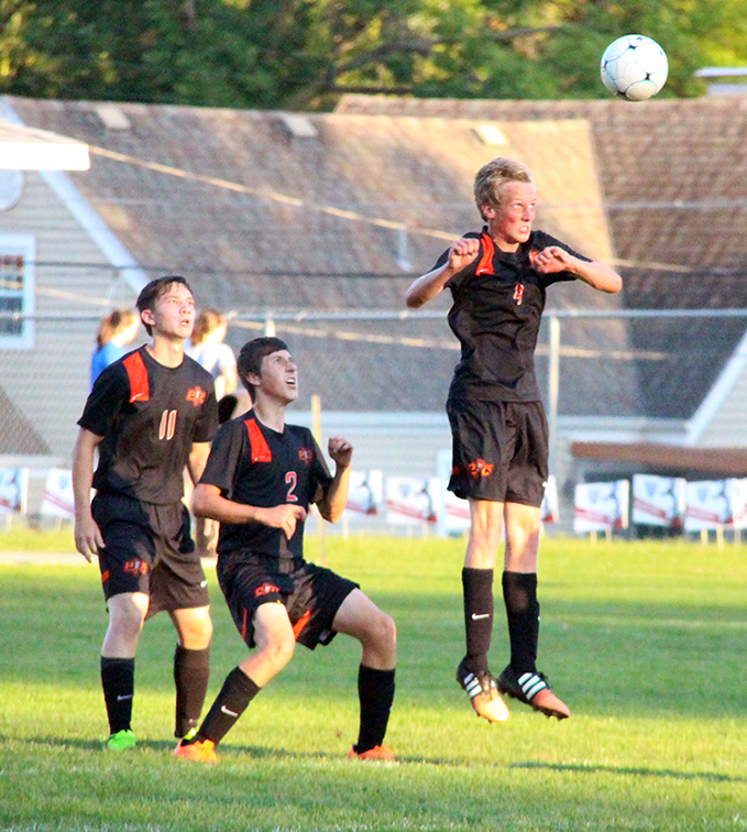 Platte County defender Mason Hays, right, jumps to head away a free kick against St. Joseph Central on Thursday, Sept. 3 at The Den in St. Joseph, Mo.