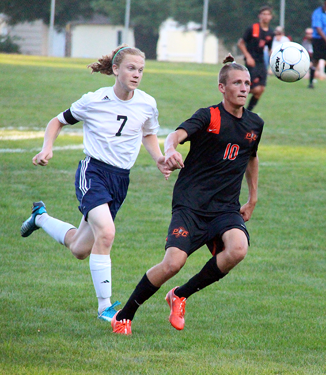 ROSS MARTIN/Citizen photo Platte County senior forward Baylor Cox, right, attempts to control the ball while St. Joseph Central senior Ben West pursues him during a game on Thursday, Sept. 3 at The Den in St. Joseph, Mo.