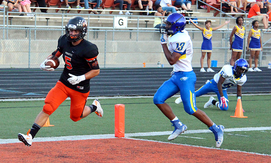 ROSS MARTIN/Citizen photo Platte County senior running back Alex Minter, left, strides into the end zone ahead of Ruskin defensive back Trevell Young during the Pirates' home opener on Friday, Sept. 4 at Pirate Stadium.