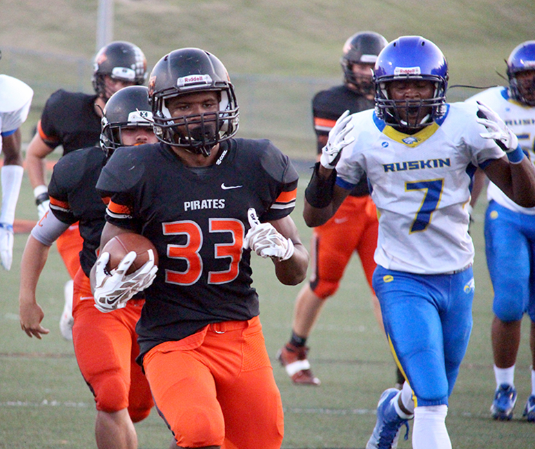 ROSS MARTIN/Citizen photo Platte County running back Mike McNair waltzes into the end zone for 1 of his 3 TDs against Ruskin on Friday, Aug. 4 at Pirate Stadium.