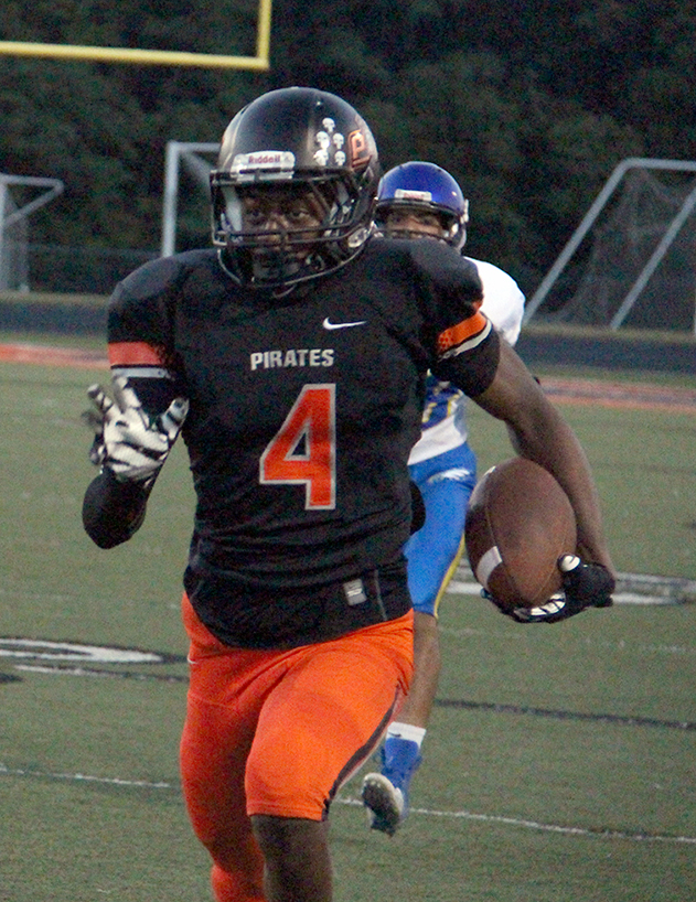 ROSS MARTIN/Citizen photo Platte County junior Kevin Neal returns an interception for a touchdown Friday, Aug. 4 against Ruskin at Pirate Stadium.