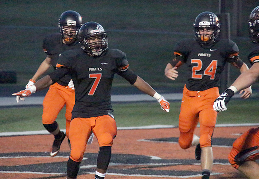 ROSS MARTIN/Citizen photo Platte County senior defensive back Lloyd Lockett, left, celebrates with teammates after his interception return for a touchdown against Ruskin on Friday, Sept. 4 at Pirate Stadium.