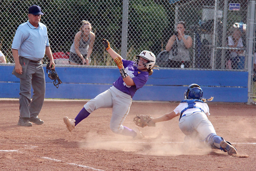 ROSS MARTIN/Citizen photo North Platte sophomore third baseman Alley Rickel slides safely into home while West Platte senior catcher Taylor Binkley attempts to apply the tag in a game Thursday, Sept. 10 at Benner Park in Weston, Mo. North Platte won the game 23-5 to move to 8-0 on the season.