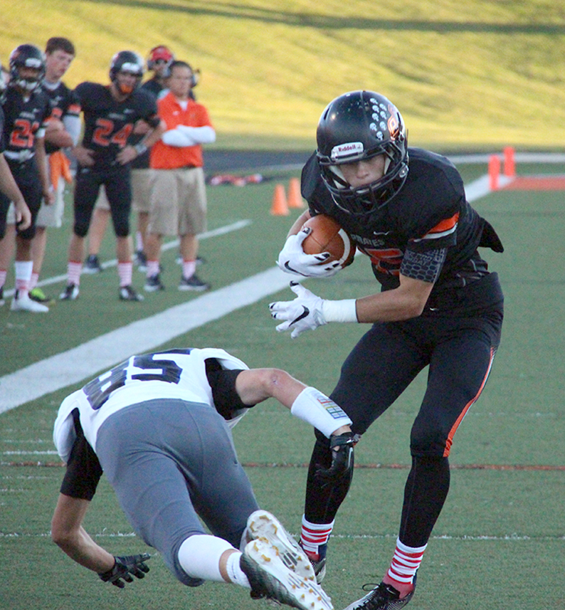 ROSS MARTIN/Citizen photo Platte County wide receiver Zach Hamilton, right, jukes past Park Hill South cornerback Taylor Owens during a game held on Friday Sept. 11 at Pirate Stadium.