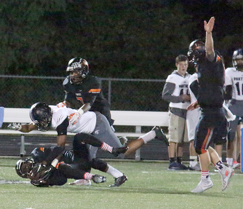 ROSS MARTIN/Citizen photo Platte County junior safety Kevin Neal, left on the ground, hauls in an interception as teammat Justin Mitchell, right, celebrates in the second half against Park Hill South on Friday, Sept. 11 at Pirate Stadium.