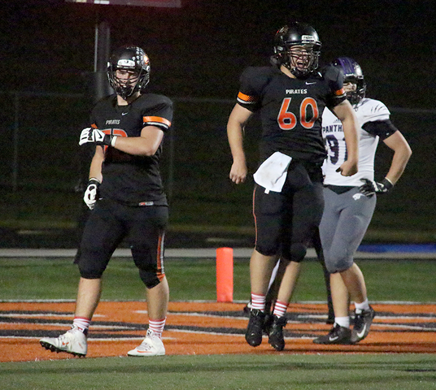 ROSS MARTIN/Citizen photo Platte County junior offensive lineman Derek Kohler, left, and Casey Jumps (60) celebrate the Pirates final touchdown of a 37-7 win against Park Hill South on Friday, Sept. 11 at Pirate Stadium.