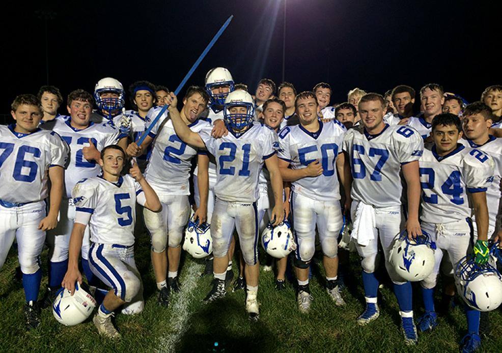 ROSS MARTIN/Citizen photo West Platte senior Justin Rhodes (21) holds aloft The Tobacco Stick traveling trophy after West Platte's 48-14 win against North Platte on Friday, Sept. 18 at North Platte High School in Dearborn, Mo.