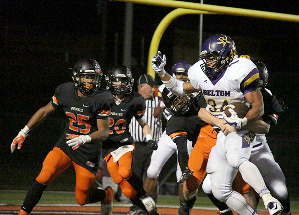 ROSS MARTIN/Citizen photo Platte County sophomore defenders Kobe Cummings (25) and JP Post (20) look to help bring down Belton running back Zach Willis on Friday, Sept. 25 at Pirate Stadium. Willis finished with 300 yards rushing on 39 carries in Belton's 50-24 victory.